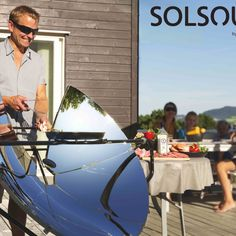 Man solar cooking with SolSource solar cooker.