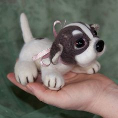 """Mamiko is a lovely little needle felted puppy, about 8 cm (3"""") tall and 13.5 cm (5"""") long made with merino wool. It has a lovely heart on its side and glass bead eyes."""