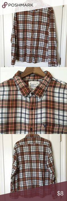 Men's American Eagle Plaid Flannel Shirt Men's American Eagle XL Plaid Flannel Shirt. The colors are burnt orange, light blue, brown. American Eagle Outfitters Shirts Casual Button Down Shirts