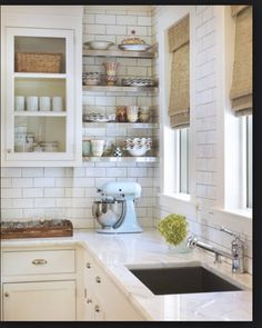 Open shelves, subway tiles and white cabinets.