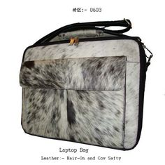 This is a Laptop Bag made in Cow Hair-On Leather.
