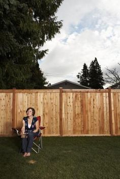 How To Convert A Chain-link Fence To A Wooden Fence