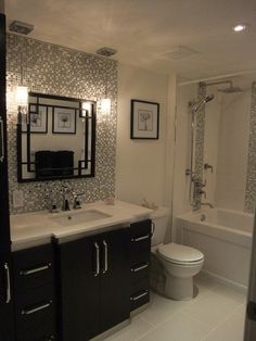 tile backsplash behind vanity…mirror and hanging pendant lights