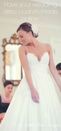 Lace and taffeta wedding gown with hidden pockets that can be made to your measurements and specifications. By Bridal Bliss Designs - in the USA