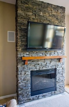 Love a stone fireplace. so easy to do with our faux stone sheets ...