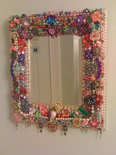 Vintage Jewelry Art My mom visited this past weekend, and here's the project we did- a 'jewelry mirror.' We had so much fun picking through the jewelry we . Jewelry Frames, Jewelry Art, Silver Jewelry, Cheap Jewelry, Diy Jewelry Mirror, Jewelry Ideas, Beaded Mirror, Silver Earrings, Stud Earrings