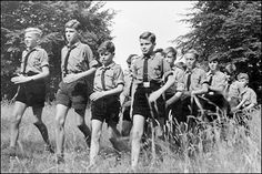 A common scene in the German countryside--Hitler Youths on a brisk military-style hike.