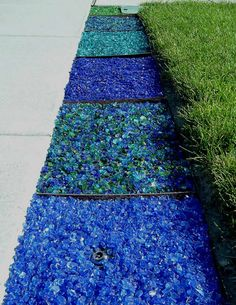 Tumbled glass mulch - so cool in just the right place! Maybe in a pool area? Like the lighter colors.