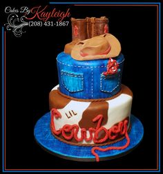 Western Boy Baby Shower Cake.  This is a two tier western baby shower cake with cowboy hat and boots made from fondant.  The top tier is blue jeans sitting on top of a cow hide with the word lil branded into it.  If you like this cake please check out more of my work at https://www.facebook.com/cakesbykayleighboesiger