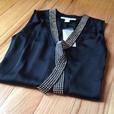 HOST PICKNEW Michael Kors Top HOST PICK @ Glam Girl Party 8-31-15GORGEOUS!  Michael Kors Black sleeveless embellished Top. Great or that GNO or for upcoming Holiday parties!   Goes with anything. Stunning fit!  Made of 100% polyesterno trade no PPPRICE IS FIRM Michael Kors Tops