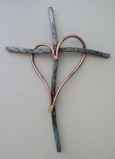 Cross is 13 to 14 tall x 8-1/2 to 9-1/2 wide handcrafted of hammered metal, with copper rod heart. Each piece is handcrafted so it would look almost the same but heart shape, and curve in cross may be slightly different. Each is an original. Hole in back of cross to hang flat on wall. Each piece is numbered. the number and signature are engraved on the back.
