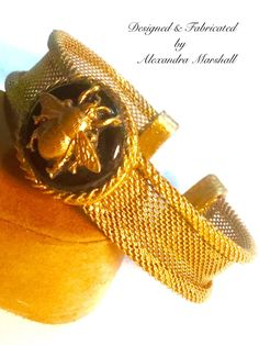 You will love this artisan crafted florentine gold finished mesh cuff/bracelet by Alexandra Marshall featuring a black Agate Cabochon embellished with a golden bee. #2364. $69. Double click photo to order.