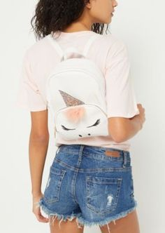 4e22a1a4 A faux leather mini backpack designed with unicorn details featuring  embroidered eyes and nose, glitter
