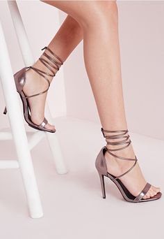 Step out in style this season in these fierce barely there heeled sandals in a futuristic pewter finish. Featuring an on trend lace up finish which can be wrapped around your ankle in different ways and built in cushion to the sole for ulti...