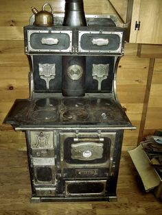 Here's the wood burning Monarch Malleable Steel Range, circa1910. Note the nickel plated trim, including two fold-down Trivets. The stove top could be used to heat sad irons.
