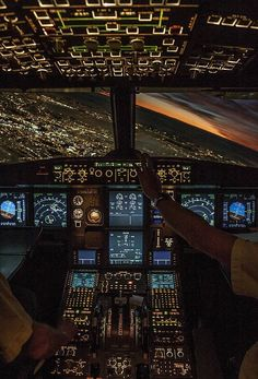 View of a City at Night from an Airplane Cockpit - photo from persbaglio ...photographer not listed...