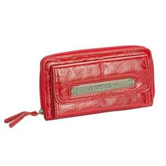 """This fashionable and functional long plate wallet holds all of your daily needs. It has a total of 18 credit card slots! The front snap pocket has 12 credit card slots and 1 ID window. Unzip the wallet to find 6 more credit card slots! Also inside are 3 side pockets, 2 large sections and a middle zipper pocket. Detailed Product Information:Closure: ZipperMeasures: 9.25"""" long 4.25"""" wide .66"""" deep"""