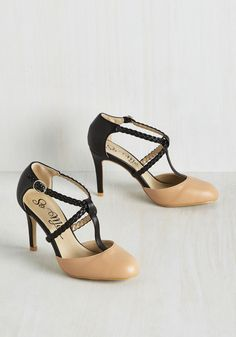 You specialize in chic entrances, which is why you chose these strappy heels for your grand gallery debut! Boasting a black heel, braided, intersecting bands, and a delicate round toe in a soft taupe hue, these vegan-friendly faux-leather pumps are a masterpiece in themselves!