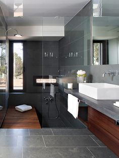 "Stylish Dark Bathroom...love the combo of the cold dark with the cool/warm ""teak"""