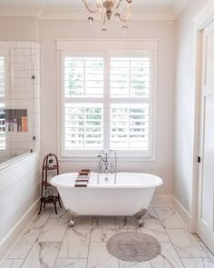 Plantation shutters, combined with our Cambridge Clawfoot Tub and a beautiful porcelain tile, make for a breathtaking farmhouse bathroom. Bathroom Window Treatments, Easy Home Decor, Interior Shutters, Sliding Patio Doors, Window Styles, Tub, Clawfoot Tub, Bathtub Design, Shutters