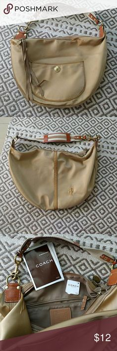 Authentic Coach large satin hobo Authentic Coach satin hobo. This is used. It didn't hold up as well as other Coach bags. It has gotten very discolored in several spots and the material has wrinkled. I don't know how to fix it. It still has a usable handle and hardware. The dust bag got lost in a move. Coach Bags Shoulder Bags