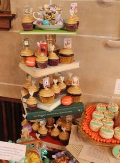 A four-tiered cupcake stand  (made from hardcover books and wooden candlesticks painted gold)
