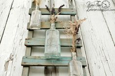 Apothecary Bottle Flower Display created on Antique Rocking Horse Base by KnickofTime