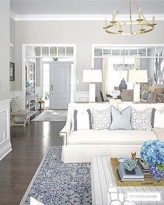 Beautiful and bright spring living room decorating in blue, white and brass plus our new gorgeous brass chandeiers and wall sconces! Southern Living Rooms, Coastal Living Rooms, Rugs In Living Room, Home And Living, Living Room Designs, Living Room Decor, Living Spaces, Blue And White Living Room, Classic Living Room