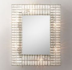 RH TEEN's Illuminated Crystal Rectangular Mirror:Replete with hundreds of reflective crystals in a simple metal frame, this illuminated mirror serves as a stunning statement piece.
