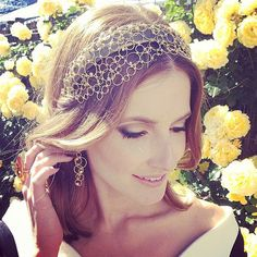 Kate Waterhouse: Nerida Winter headpiece and Hardy Brothers jewels. Melbourne Cup 2013.