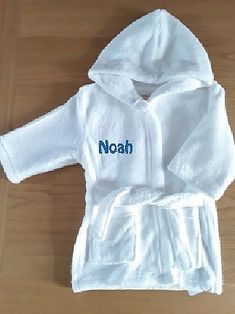 Perfect for keeping your little one cosy after bath time or putting on over pyjamas on a chilly morning. These soft and cuddly hooded dressing gowns are available in 3 sizes. Your babies name will be embroidered on the front for Free. Christmas Competitions, After Bath, Personalised Gifts, Bath Time, Pyjamas, Gift Bags, Baby Names, Put On, Cute Kids