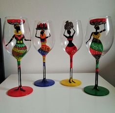 Four wine glasses each with a different lady and different colour of bottom. Hand painted wine glasses with african theme African Crafts, African Home Decor, African Art, Glass Bottle Crafts, Diy Bottle, Bottle Art, Deco App, African Party Theme, Traditional Wedding Decor