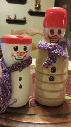Repurposed creamer containers make great hot chocolate containers to give as gifts. I added a crocheted scarf, but a cut-up piece of holiday material or felt would work also. I drew the faces on with permanent markers. I wrote instructions for making a cup of hot chocolate on the reverse side.