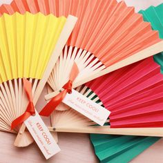 Solid color paper hand fans for a summer wedding