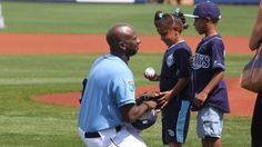 CM1 Patrick Jackson of US Navy Seabees surprises his kids by catching the first pitch thrown out by them in the home opener. The Rays recognized the military with a special tribute to the men & women of Charlotte County in the military which included Jackson. (3-2-16)