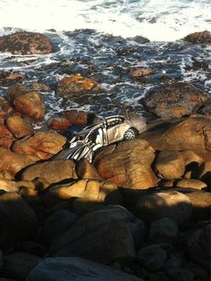 This is the Jag that went over a cliff at Bakoven, Cape Town at The driver is lucky to be alive. Cape Town, Cliff, Road Trips, South Africa, Water, Outdoor, Gripe Water, Outdoors, Outdoor Living
