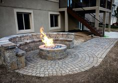 Paver Fire Pit, seating and Bench built by Nite Scapes.