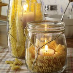 Jars filled with pasta for the Spaghetti Dinner. What great inexpensive center pieces for a fundraiser!