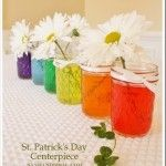 A St. Patrick's Day Centerpiece inspired by the rainbow. Simply fill mason jelly jars with water, add a few drops of food coloring and stir. Place a daisy (with the GOLD COIN centers) in each jar and tie with a ribbon.