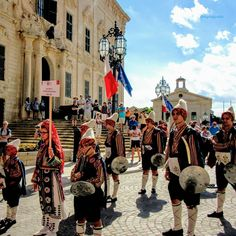 A colourful procession parades through downtown Valetta, Malta for #gramoftheday theme #PEOPLE at #gotd_2184 📷 📷 📷 📷 📷 #dogladysden #traveladdict #photographer Malta's cultural influences stem largely from the country's history of foreign domination and the influence of the Roman Catholic Church. Folk traditions have evolved mainly around the festa that celebrates the patron Saint of a village, which is marked by processions and fireworks. 🇲🇹🇲🇹🇲🇹🇲🇹🇲🇹🇲🇹 #Valetta #Malta Las Vegas Trip, Patron Saints, Roman Catholic, Malta, Fireworks, Folk, Street View, Entertainment, Culture