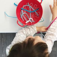 It's a rainny weekend so i had a few activities off my sleeve in case we got the home fever...this is super easy and no prep, just a bunch of coloured pipe cleaners and a small colander. I showed her how to thread the pipe cleaner once and she spent a good 15min playing with it. we did this yesterday and she went back to play with it again today. She was never really interested in pipe cleaners before, so i was happy to see this work. (Julia at 2y3m)