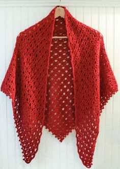 This gorgeous lace shawl crochet pattern is so modern and trendy but yet has an elegant vintage vibe. Wear it to dress up your favorite pair of jeans or for a classy night out. The pattern features a beautiful beaded edging that adds a bit of fun and sparkle. This is a classic piece that will be sure to become a staple in your wardrobe for years to come.