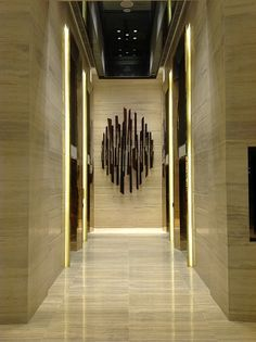 Stone Elevator Lobby with Lighting Detail and Art work