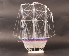 Glass Frigger, made in St Helens Lancashire as a glass fully rigged Ship, in length and at its highest in clear blue and red glass.