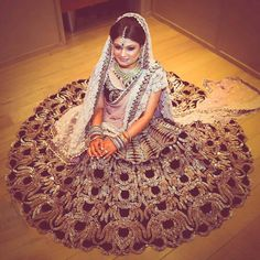 """Go unconventional for your sangeet or reception with a trendy black lehenga like this one with shimmery gold embroidery and a contrasting lavender dupatta…"""