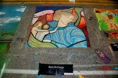 Literally art on the street, Houston's Colori features loads of artists temporary chalk masterpieces...I love the cat in the corner.