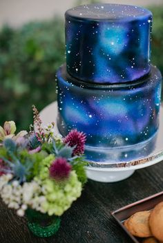 How dreamy is this space wedding cake? I would have no way to DIY this, though, and so probably would be best off leaving this to a professional... would one or two red roses and the silhouette cake topper I like be too much?