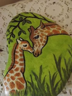 """This is my graceful Giraffe Baby and Mom that I hand painted on a smooth River rock. This rock measures 6 1/2: long by 3 1/2"""" wide. It has been signed, dated and sealed. Would make a great gift or paperweight. Thank you for visiting! 