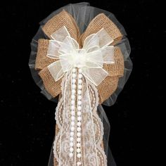 """This rustic ivory and burlap wedding bow is the perfect combination of burlap and lace for a rustic theme wedding. These rustic bow for perfect for church pew decorations. Bow Size: - 8 loops of 6"""" iv"""