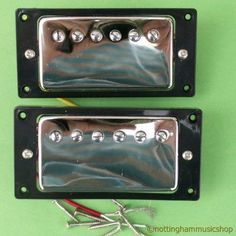 2 ELECTRIC GUITAR CHROME HUMBUCKER PICKUPS WITH BLACK SURROUNDS